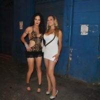Latina tranny Nikki Montero and a trans prostitute show some leg while hooking