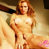 Leggy Tgirl Alessandra Blonde works a sex toy up her asshole while masturbating