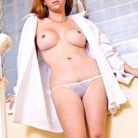 Sexy Japanese ladyboy Sapphire Young frees her big tits and dick in solo action