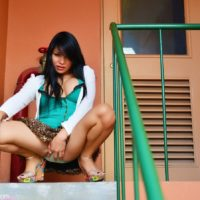 Solo ladyboy Vitress Tamayo flashes her big tits and upskirt panties on a balcony