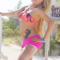 Blonde trans model Karla Carrillo looses her firm boobs from a bikini in pink shorts