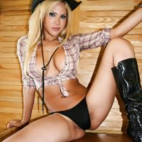 Sexy blonde tranny Mlla Viasotti strokes her cock wearing farm girl clothes and boots