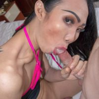 Slim ladyboy Swan sucks on the ball sac during a blowjob before BB anal sex on a bed