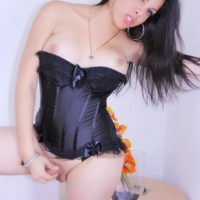 Asian ladyboy Vivian Black looses her tits from a corset before stroking her cock