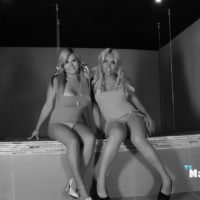 Blonde shemale Naomi Chi kisses another blonde tranny in a black and white shoot