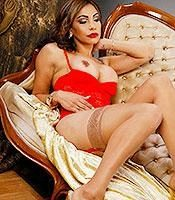 Gorgeous tranny Angeles Cid lets her massive cock loose in sexy lingerie and nylons