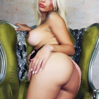 Sexy blonde transsexual Angeles Cid twerks her booty before baring big tits and cock