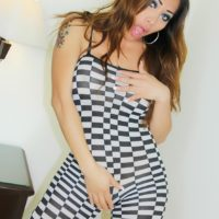Sexy tranny Nina Stronghold frees her big tits and cock from checker board attire