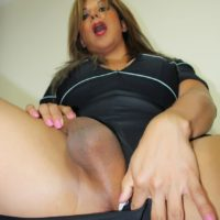 Busty trans woman Naomi Chi looses her cock from a dress during solo action