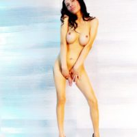 Leggy shemale Nikki Montero tugs on her big cock in heels after removing lingerie
