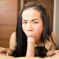 Brunette ladyboy Joy sucks on a large cock before taking it up the ass during POV sex