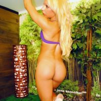Natural blonde tranny with a phat ass takes her hard cock out from bikini bottoms