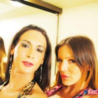Shemale lovers partake in POV sex acts in front of a mirror while wearing dresses