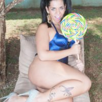 Latina shemale Kessia Brunelly holds her bubble butt while being ass fucked by a man