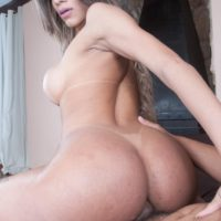 Latina shemale Melany Vilhena parks her big booty on a big cock after a blowjob