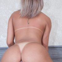 Blonde Latina shemale Bianca Hills gets on a big cock while fucking in nylons