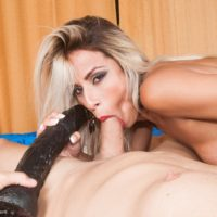 Blonde Latina tranny Bruna Lovately plays anal games on a bed with her man friend