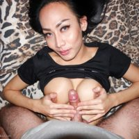 Dark haired ladyboy Bella tugs on a big dick after a tit fuck and bareback anal sex