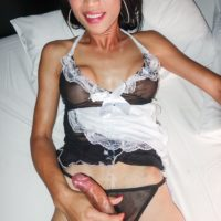 Ladyboy maid Natty goes ass to mouth with her employer while in her uniform