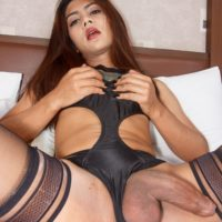 Teen ladyboy Manaw licks a man's cock and asshole before having her cock jerked