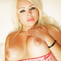 Blonde Latina shemale Afrika Kampos showcases her cock with her big boobs on display