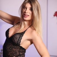 Blonde Latina tranny Angelina Torres exposes her cock while wearing black lingerie