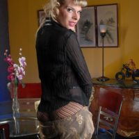 Blonde trans model Angelina Torres exposes her small tits while wearing pantyhose