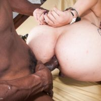 Brazilian shemale Achylla Santos takes on a big black cock while handcuffed on a bed