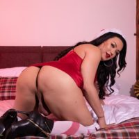 Brunette shemale Bianka Nascimento strokes her big cock during a naughty Xmas shoot