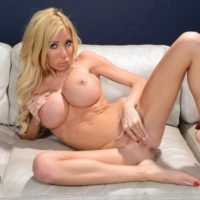 Busty blonde post-op tranny Kimber James showcases her pussy while going barefoot