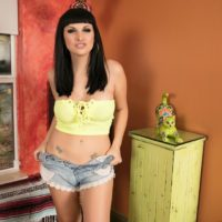 Dark haired tranny Bailey Jay unzips cutoff shorts to set her ass and shecock free