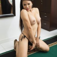 Hot Asian ladyboy Vitress Tamayo touts her bare ass while topless in front of a mirror
