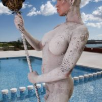 Inked blonde trans girl Danni Daniels poses for a great nude solo shoot by a pool