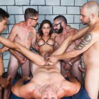 Latina shemale Gabi Ferrari gets gangbanged by a willing group of men in footwear