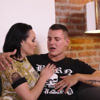 Latina tranny Angelina Torres exchanges oral sex with her boyfriend while on a sofa
