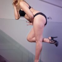 Long legged blonde shemale Angelina Torres takes off a black dress and brassiere