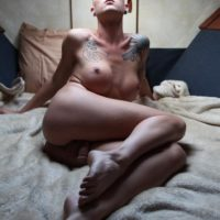 Long legged blonde trans girl Danni Daniels fondles her big tits while showing her cock