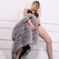 Long legged blonde trans model Angelina Torres strikes tempting poses in a fur coat