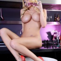Long legged blonde transsexual Kimber James dildos her post-op pussy in high heels