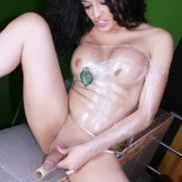 Teen trans girl Keira Verga plays with her cock while wearing plastic wrap and high heels