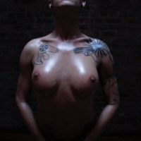 Totally naked transsexual model Danni Daniels strikes confident poses in solo action