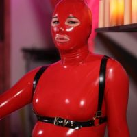 Transsexual model Bianka Nascimento poses for a SFW shoot in head to toe latex wear