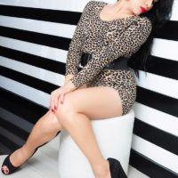 Asian ladyboy Vitress Tamayo sports red lips during upskirt action during a solo gig