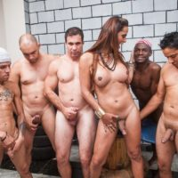 Brazilian shemale Laura Araujo does a gangbang scene with black and white men