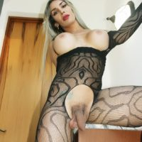 Big-boobed ash-blonde TS Nelly Ochoa flaunts her enormous boner in a crotchless bodystocking