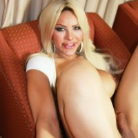 Bosomy blonde TS Azeneth slides a toy up her starfish while tugging on her dick