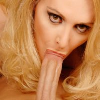 Huge-chested platinum-blonde shemale delivers a blowjob before no condom ass banging