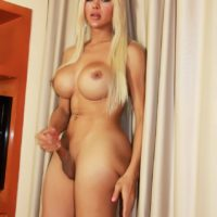 Massive breasted trans-girl model TS Azeneth shows her hefty clean-shaven dick