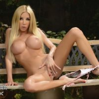 Post-op trans model Kimber James peels off a bikini to model naked on a patio bench