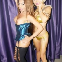 Sweet Latina transsexual Tania Quintilla releases a boob alongside a sandy-haired transgirl babe